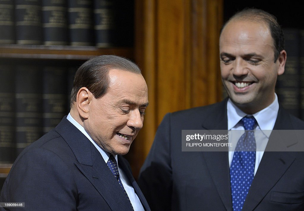 This file picture taken on May 25, 2012 at the senate in Rome shows former Italian Prime Minister Silvio Berlusconi (L) taking place for a press conference with the secretary general of the Popolo della Liberta (PDL) party, Angelino Alfano. Berlusconi said on January 7, 2013 he has re-established his historic alliance with the anti-immigration Northern League party in a move which could make February elections significantly closer and the post of prime minister 'will be decided if we win' but could go to the PDL secretary Angelino Alfano.