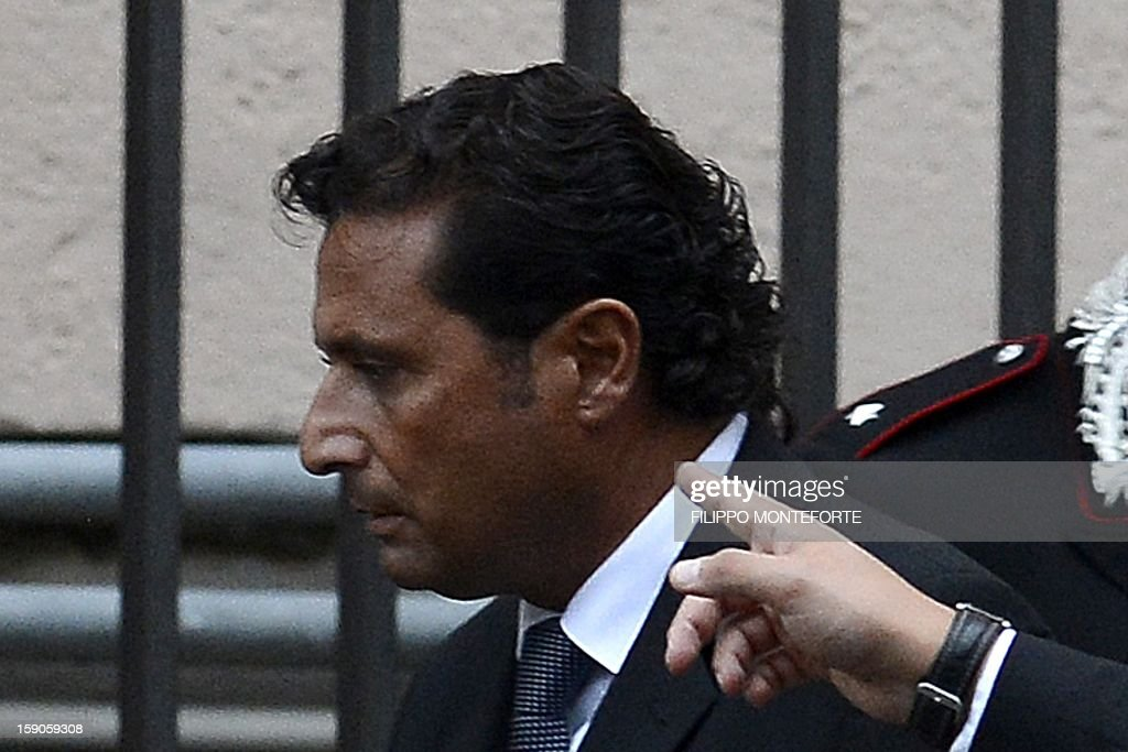 This file picture taken on October 15, 2012 shows the captain of the Costa Concordia Francesco Schettino leaving after hearings at a Grosseto court to work out the details of the tragic night of the Costa Concordia disaster. Schettino, the captain of the luxury cruise liner which crashed off the coast of Italy nearly a year ago, killing 32 people, said on January 7, 2013 he had been depicted as worse than Osama bin Laden.