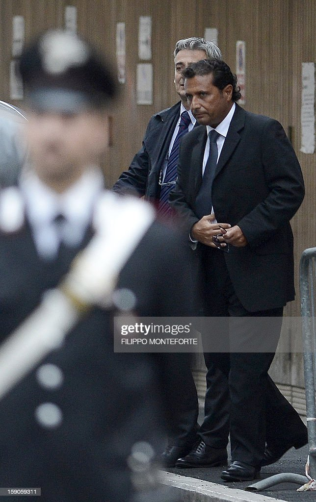 This file picture taken on October 15, 2012 shows the captain of the Costa Concordia Francesco Schettino leaving after hearings at a Grosseto court to work out the details of the tragic night of the Costa Concordia disaster. Schettino, the captain of the luxury cruise liner which crashed off the coast of Italy nearly a year ago, killing 32 people, said on January 7, 2013 he had been depicted as worse than Osama bin Laden. AFP PHOTO / FILES / FILIPPO MONTEFORTE