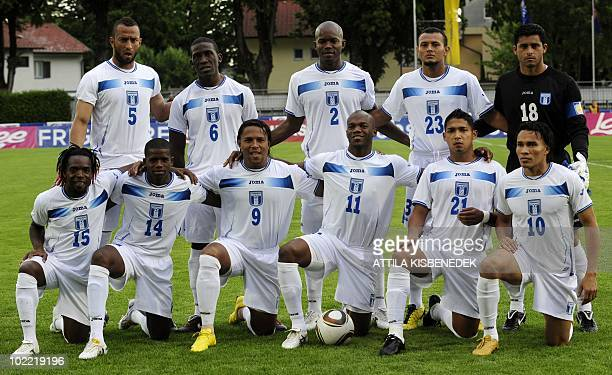 This file picture taken on on May 27 2010 in the local stadium of Villach shows Honduras' players Walter Martinez Oscar Garcia Carlos Pavon Oscar...
