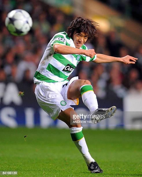 This file picture taken on September 17 2008 in Glasgow shows Celtic's Japanese midfielder Shunsuke Nakamura shooting a free kick at the Aalborg goal...