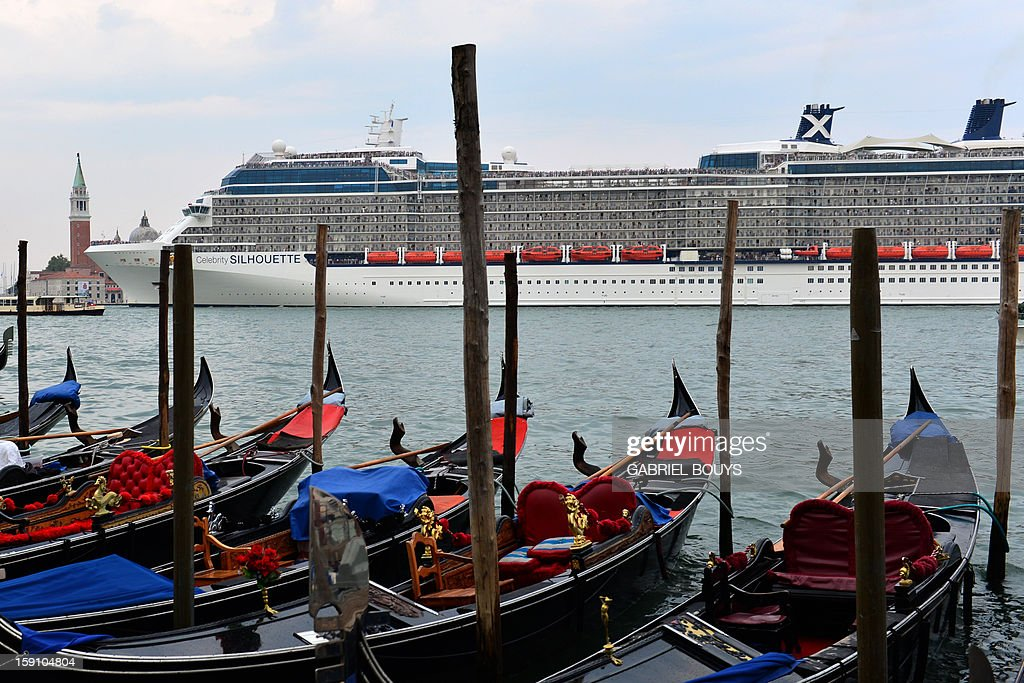 This file picture taken on September 4, 2012 in Venice shows a cruise ship passing by St Mark's square. A year after the shipwreck of the Costa Concordia luxury liner off Giglio island, cruise ships are still sailing close to the coast in Venice.