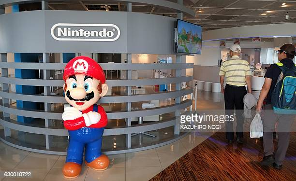 This file picture taken on September 8 2016 shows the logo of Japanese gaming giant Nintendo and its game character Super Mario at a show room in...
