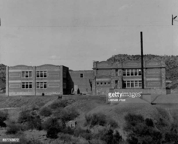 This fine high school building will be abandoned when the little mining town of Dawson N M is closed down April 28 less new industry is found to keep...