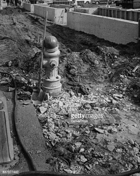 This fire hydrant at 14th and Lawrence Sts does double duty as a conveniently converted hat rack and shovel stand during a lull in construction at...