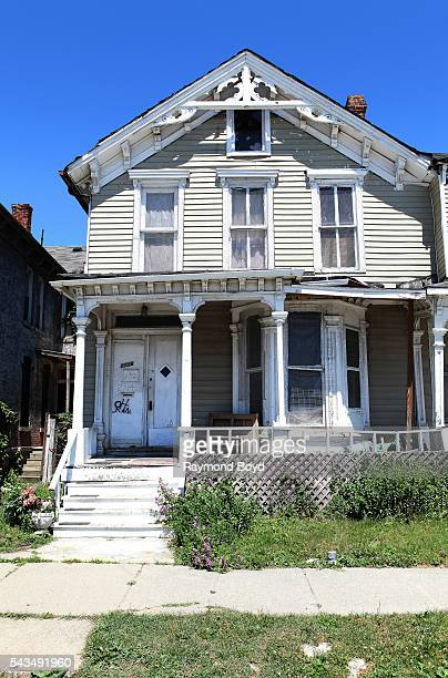 This firedamaged Cass Corridor house in the shadow of the new Little Caesars Arena home of the Detroit Red Wings hockey team are amongst the few...