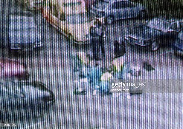 This frame from Dutch television shows the medical personnel working on controversial rightwing politician Pim Fortuyn after he was shot six times by...