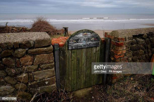 This gate with a sign for Cliff Farm leads straight into the North Sea The farm close to Skipsea has been left teetering on the edge and will be...
