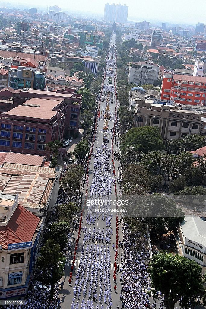 This general aerial view shows the Royal floats during the funeral procession for the late former King Norodom Sihanouk in front of the Royal Palace in Phnom Penh on February 1, 2013. A sea of mourners filled the streets of the Cambodian capital on February 1 for a lavish funeral for revered former king Norodom Sihanouk, who towered over six tumultuous decades in his nation's history. AFP PHOTO/ Khem Sovannara