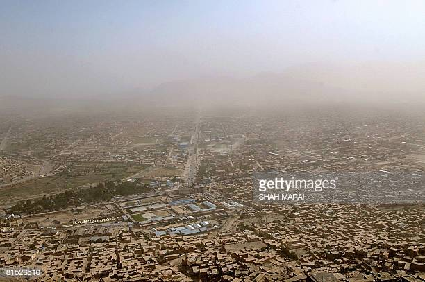 This general view from a hilltop overlooking Kabul on June 11 shows the progress of a dust storm across the city Afghanistan is a mountainous country...