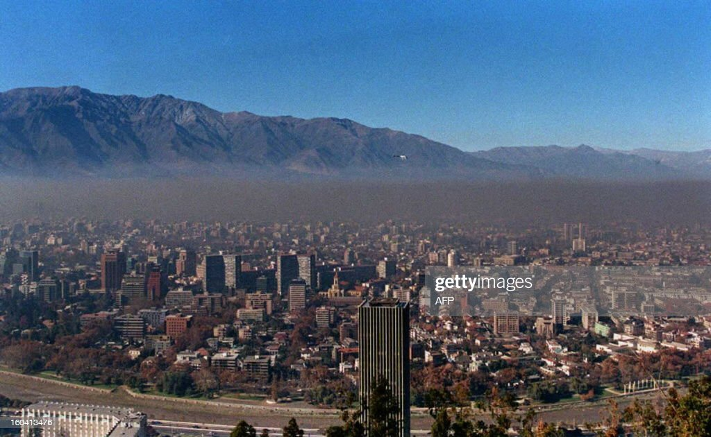 This general view of Santiago,Chile,shows the layer of air pollution which sits on the Chilean capital 04 June as the southern hemisphere goes into the winter season. The permanent high level of pollution is caused by the local industries and a growing number of cars. AFP PHOTO/Martin THOMAS /