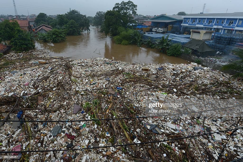 This general view picture shows garbage covering the Ciliwung river while many areas in the capital and its satellites are hit by floods in Jakarta on January 21, 2014. More than 4,300 people in the capital have been displaced by the floods, which also worsened the city's notorious traffic jams.