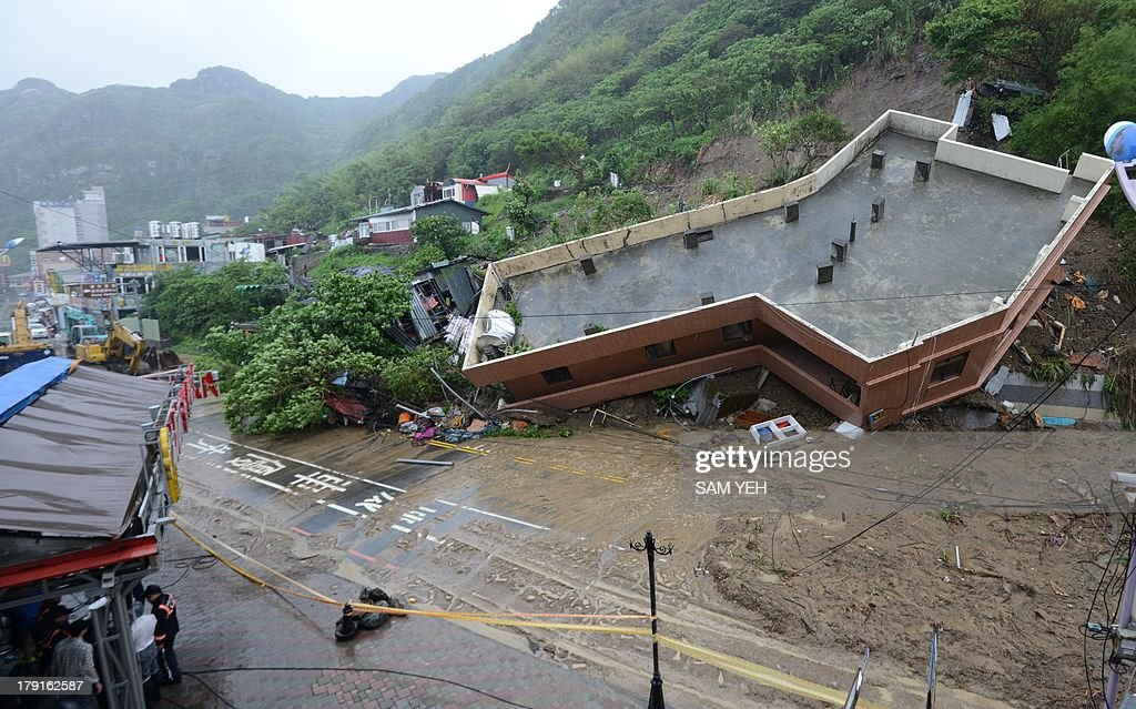 This general view shows a building damaged after heavy rains hit Taiwan's northern city of Keelung on September 1, 2013. Tropical Storm Kong-Rey pounded Taiwan, leading to widespread flooding in the south that left three people dead and caused more than 11 million USD in agricultural damage, the government said. AFP PHOTO / Sam Yeh
