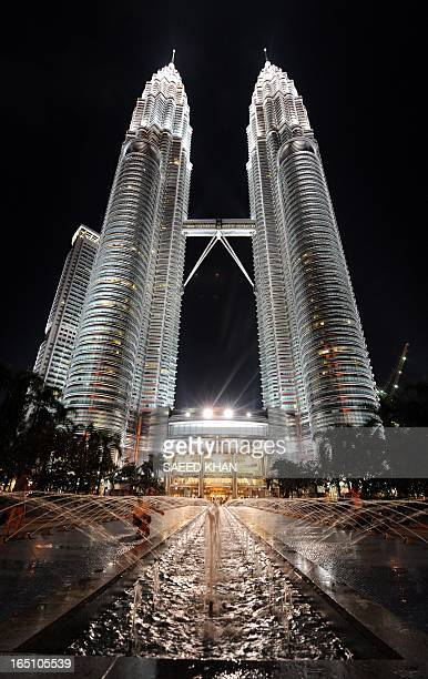 This general view shows a nightshot the Malaysia's landmark Petronas Twin Towers in Kuala Lumpur on February 6 2010 The Petronas Twin Towers were the...
