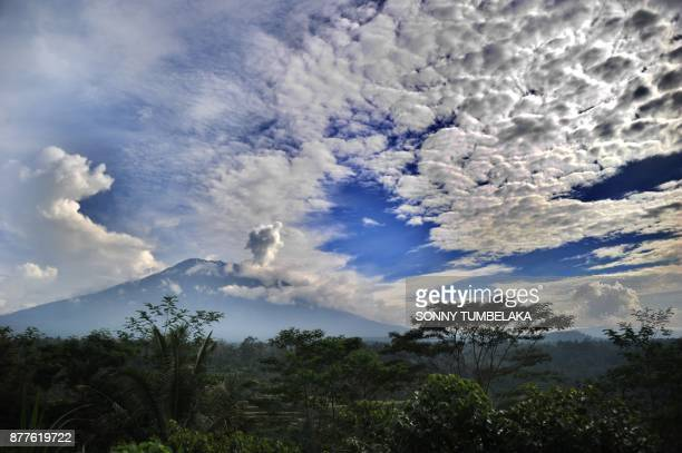 This general view shows a puff of smoke coming from Mount Agung volcano taken from the Rendang subdistrict in Karangasem Regency on Indonesia's...