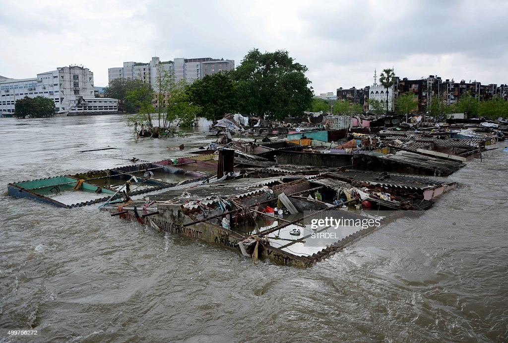 This general view shows buildings inundated by floodwaters in Chennai on December 3 2015 Thousands of rescuers raced to evacuate residents from...