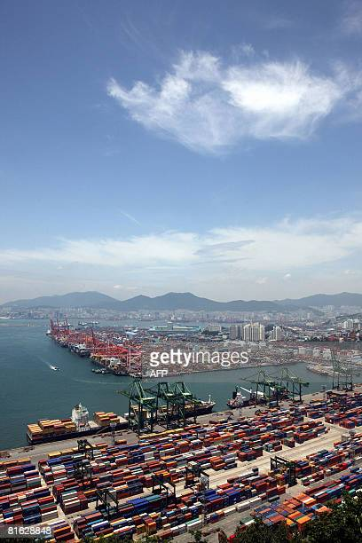 This general view shows containers stacked in the southern port of Busan 450 kilometers southeast of Seoul on June 19 2008 South Korean container...
