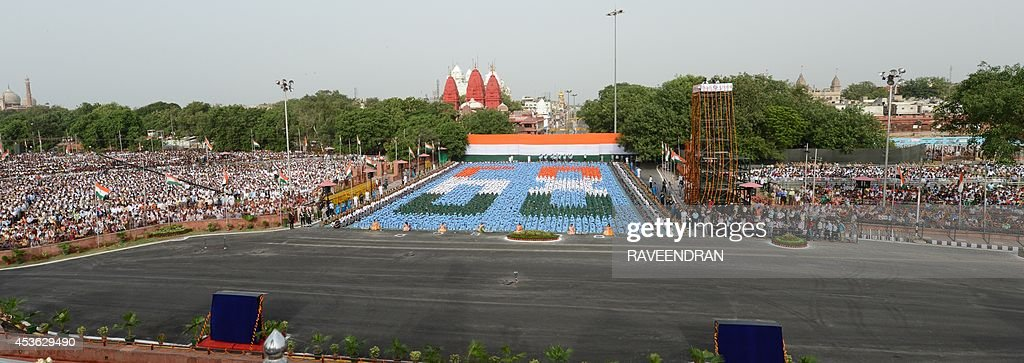 This general view shows Indian schoolchildren (C) participating in the country's 68th Independence Day celebrations at the Red Fort in New Delhi on August 15, 2014. Indian Prime Minister Narendra Modi condemned a spate of rapes as a source of shame for India and urged an end to communal violence on August 15 as he vowed to improve the lives of the nation's poor in his first Independence Day speech.