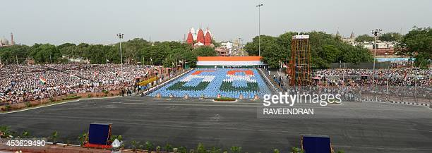 This general view shows Indian schoolchildren participating in the country's 68th Independence Day celebrations at the Red Fort in New Delhi on...