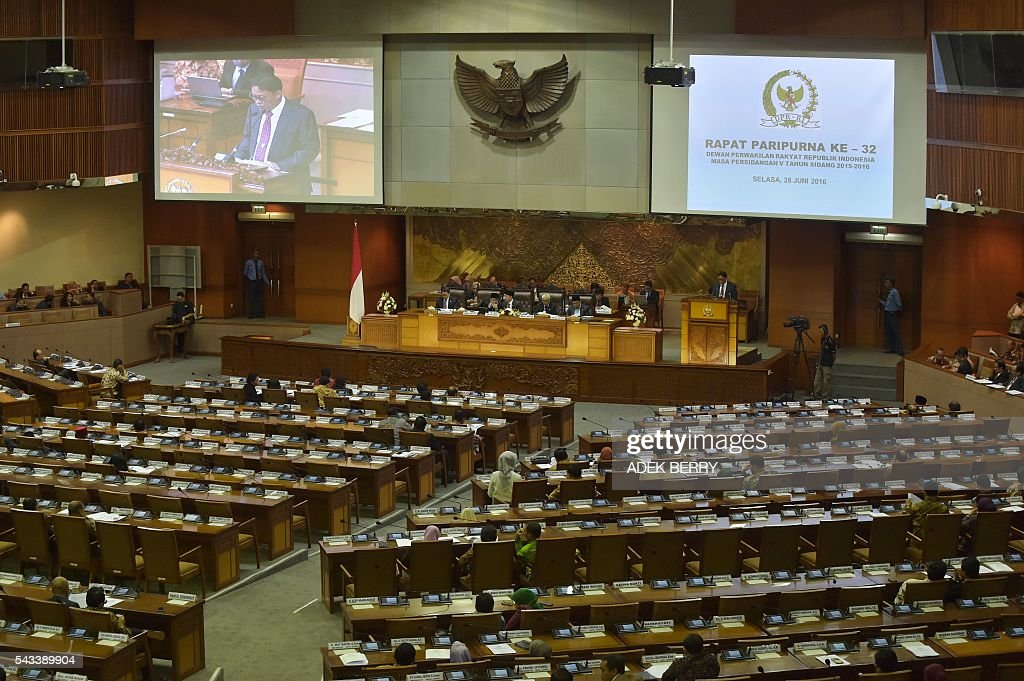 This general view shows lawmakers attending a plenary session for a tax amnesty bill at the parliament in Jakarta on June 28, 2016. Indonesia's parliament on June 28 passed a tax amnesty bill in a bid to give Southeast Asia's top economy a multi-billion-dollar boost, defying criticism the move will let evaders off the hook. BERRY