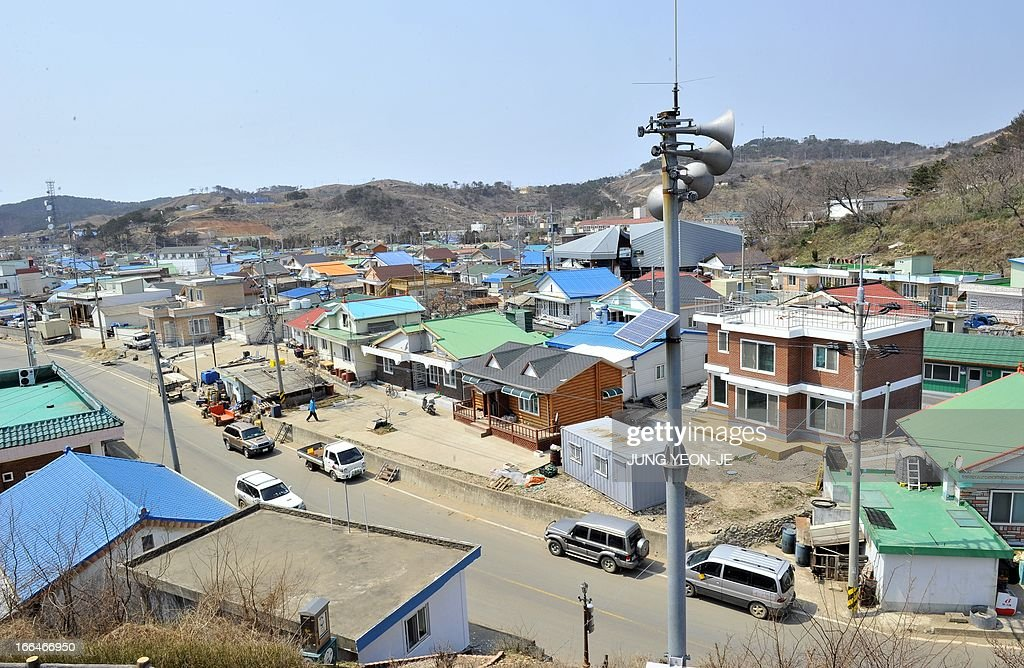 This general view shows loudspeakers stading in a village of the South Koreacontrolled island of Yeonpyeong near the disputed waters of the Yellow...