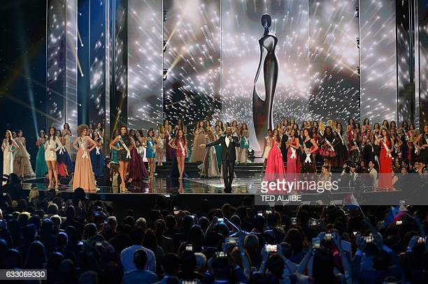 This general view shows Miss Universe candidates with pageant host Steve Harvey of the US during the finals of the Miss Universe pageant at the Mall...
