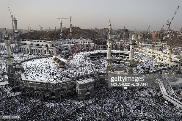 This general view shows Muslim pilgrims arriving for a prayer at Mecca's Grand Mosque home of the cubeshaped Kaaba or 'House of God' that Muslims...