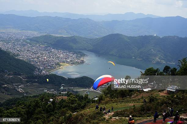 This general view shows paragliders over Pokhara Lake on April 27 following the earthquake which struck the Himalayan nation on April 25 The...
