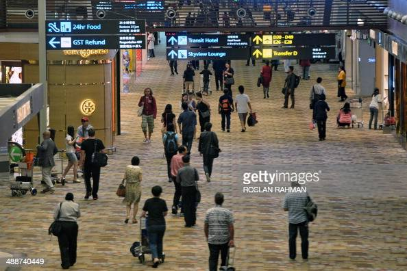 This general view shows passengers in the transit hall of Changi International Airport in Singapore on May 8 2014 Changi Airport is the fifth busiest...