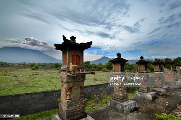 This general view shows smoke coming from Mount Agung volcano taken from Kubu in the Karangasem Regency on Indonesia's resort island of Bali on...
