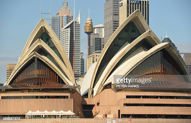 This general view shows the central business district behind the iconic Opera House in Sydney on September 17 2015 Australian real estate prices...
