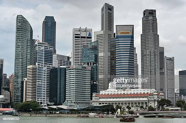 This general view shows the city skyline along Marina Bay in downtown Singapore on March 3 2015 AFP PHOTO / ROSLAN RAHMAN