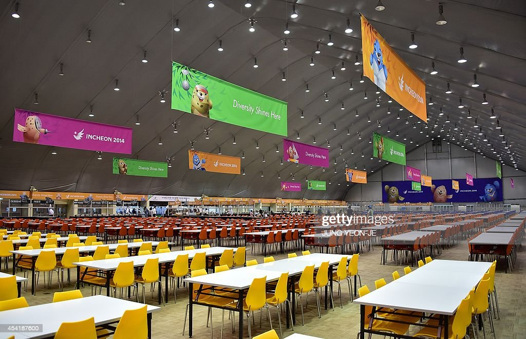 This general view shows the dining hall of the Athletes' Village for the upcoming 2014 Asian Games during a media tour in Incheon on August 26 2014...