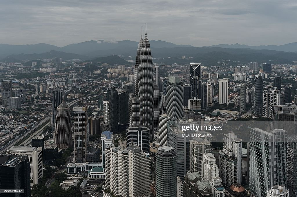 This general view shows the Kuala Lumpur city skyline from the observation deck of the KL Tower in Kuala Lumpur on May 24, 2016. Malaysia's economy expanded in the first quarter at its slowest rate since the global financial crisis, data showed on May 13, as the energy-exporting country grapples with falling oil prices and weak overseas demand. / AFP / MOHD