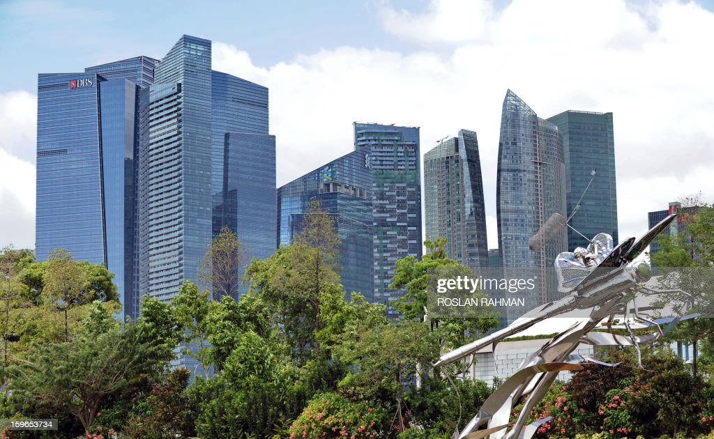 This general view shows the Marina Bay financial district buildings in Singapore on January 18, 2013. Singapore escaped a technical recession after the economy grew in the fourth quarter thanks to a boost from services, government data showed earlier this month, but prospects for 2013 remain gloomy. AFP PHOTO / ROSLAN RAHMAN