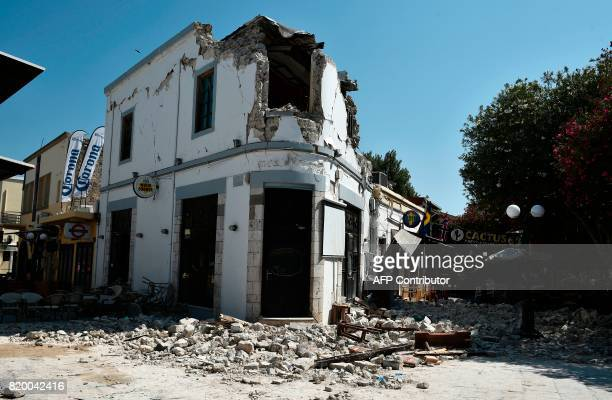 TOPSHOT This general view shows the ruins of a bar on the island of Kos on July 21 where two patrons are said to have died following a 65 magnitude...