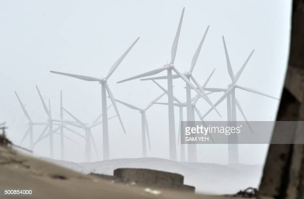 This general view shows wind turbines at the Tsu Cuo Liao wetland by the Taiwan Power Company a staterun power company in northern Taoyuan on...