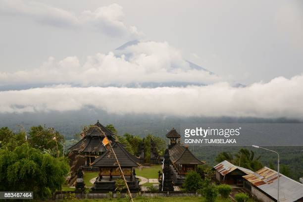 This general view taken from Lempuyang temple shows Mount Agung volcano smoldering in Karangasem Regency on Indonesia's resort island of Bali on...