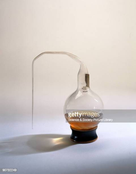 This glass flask filled with broth is a replica of one used by the French chemist and microbiologist Louis Pasteur in his experiments to show that...