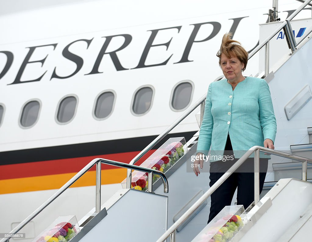 This hand out picture released by Foreign Ministry of Japan on May 26 2016 shows German Chancellor Angela Merkel arriving at the Chubu Centrair...