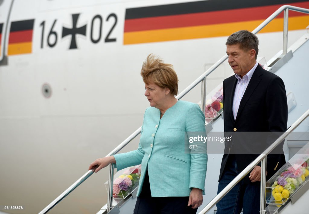 This hand out picture released by Foreign Ministry of Japan on May 26 2016 shows German Chancellor Angela Merkel with her husband Joachim Sauer...