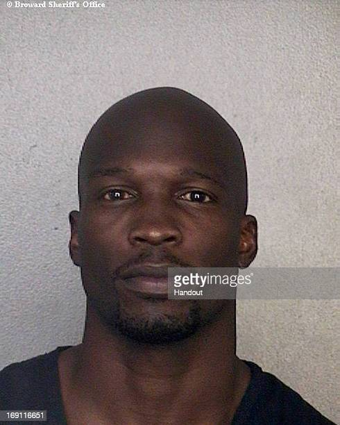 This handout booking photo provided by Broward County Sheriff's Office shows exNFL star Chad Johnson after he was arrested for violating his...