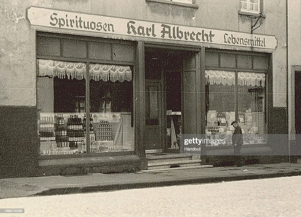 This handout image dated 1930 provided by ALDI Einkauf GmbH & Co. oHG shows an general outside view of Karl Albrecht Spiritousen and Lebensmittel shop, at Huestrasse 89 in Essen-Schonnebeck, Germany. The small store in a suburb of Essen was founded by the mother of Karl and Theo Albrecht in 1913. Aldi, which today is among the world's most successful discount grocery store chains, will soon mark its 100th anniversary and traces its history back to Karl Albrecht, who began selling baked goods in Essen on April 10, 1913 and founded the Aldi name by shortening the phrase Albrecht Discount. His sons Karl Jr. and Theo expanded the chain dramatically, creating 300 stores by 1960 divided between northern and southern Germany, with Aldi Nord and Aldi Sued, respectively. Today the two chains have approximately 4,300 stores nationwide and have also expanded into other countries across Europe and the USA. Aldi Nord operates in the USA under the name Trader Joe's.