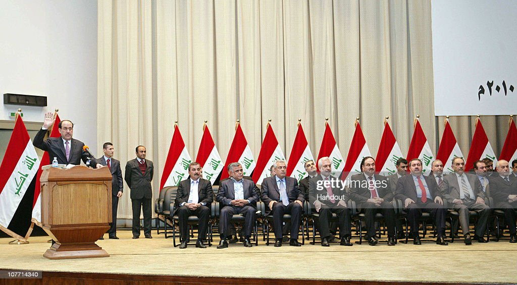 This handout image provided by the Iraqi Prime Minister Office shows Iraqi Prime Minister Nuri al-Maliki (L) and members of his newly-formed cabinet during a voting session at the Iraqi Parliament on December 21, 2010 in Baghdad, Iraq. The new government was unanimously approved, ending nine months of deadlock.