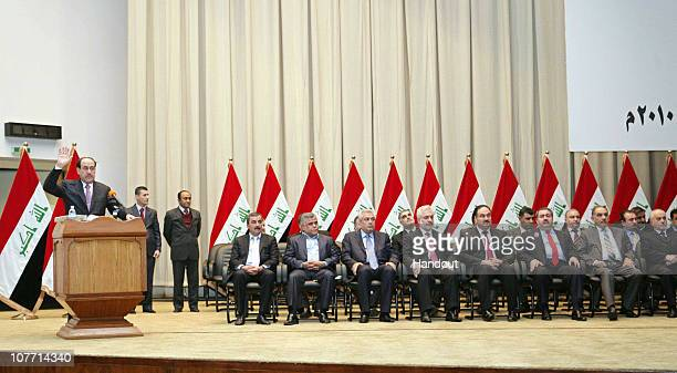 This handout image provided by the Iraqi Prime Minister Office shows Iraqi Prime Minister Nuri alMaliki and members of his newlyformed cabinet during...