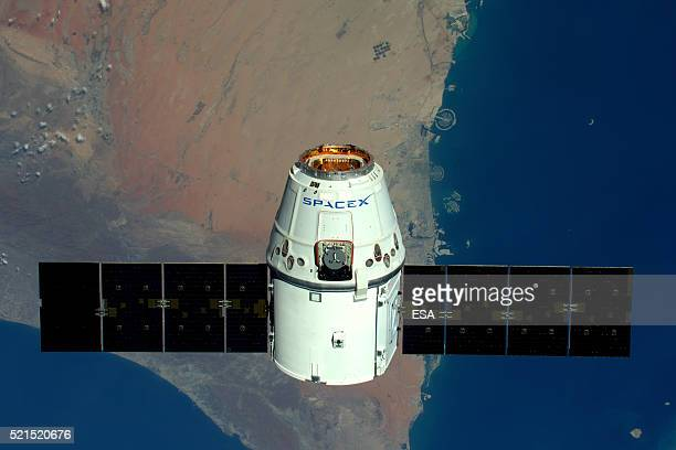 This handout image supplied by the European Space Agency shows a view of The Palms Dubai as the SpaceX Dragon spacecraft psses below in an image...