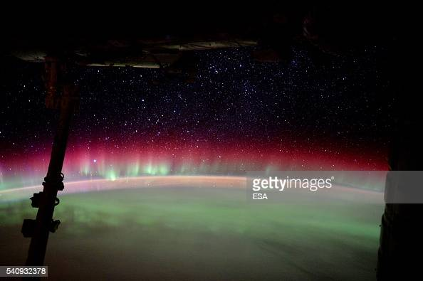 This handout image supplied by the European Space Agency shows the International Space Station passing through a magnificent aurora Australis on June...