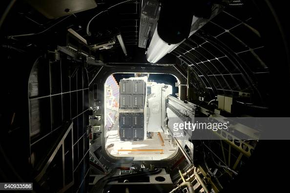 This handout image supplied by the European Space Agency shows cubesats leaving the Japanese airlock ready for launch in the International Space...