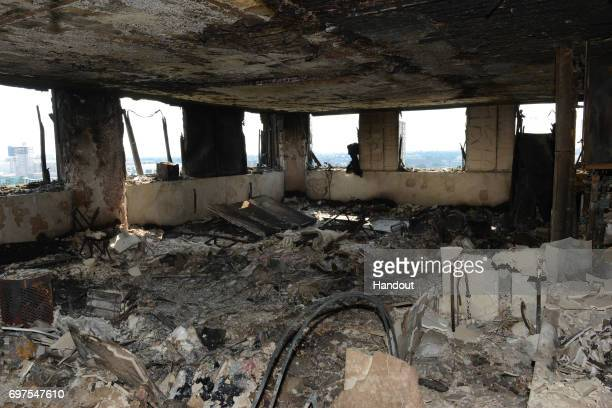 This handout image supplied by the London Metropolitan Police Service on June 18 2017 shows an interior view of a fire damaged flat in Grenfell Tower...