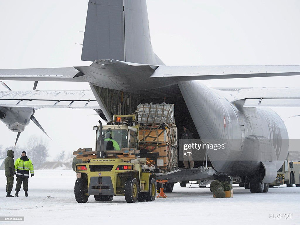 This handout photo made available on January 17, 2013 by Royal Danish Air Force Photo Service shows a Danish C130 Hercules aircraft which gets charged on stand by in Aalborg Airport on January 15, 2013 to leave for Mali. Denmark said on January 14 it would support France's military offensive in Mali by providing a Hercules military transport plane that would help ferry French troops and equipment.